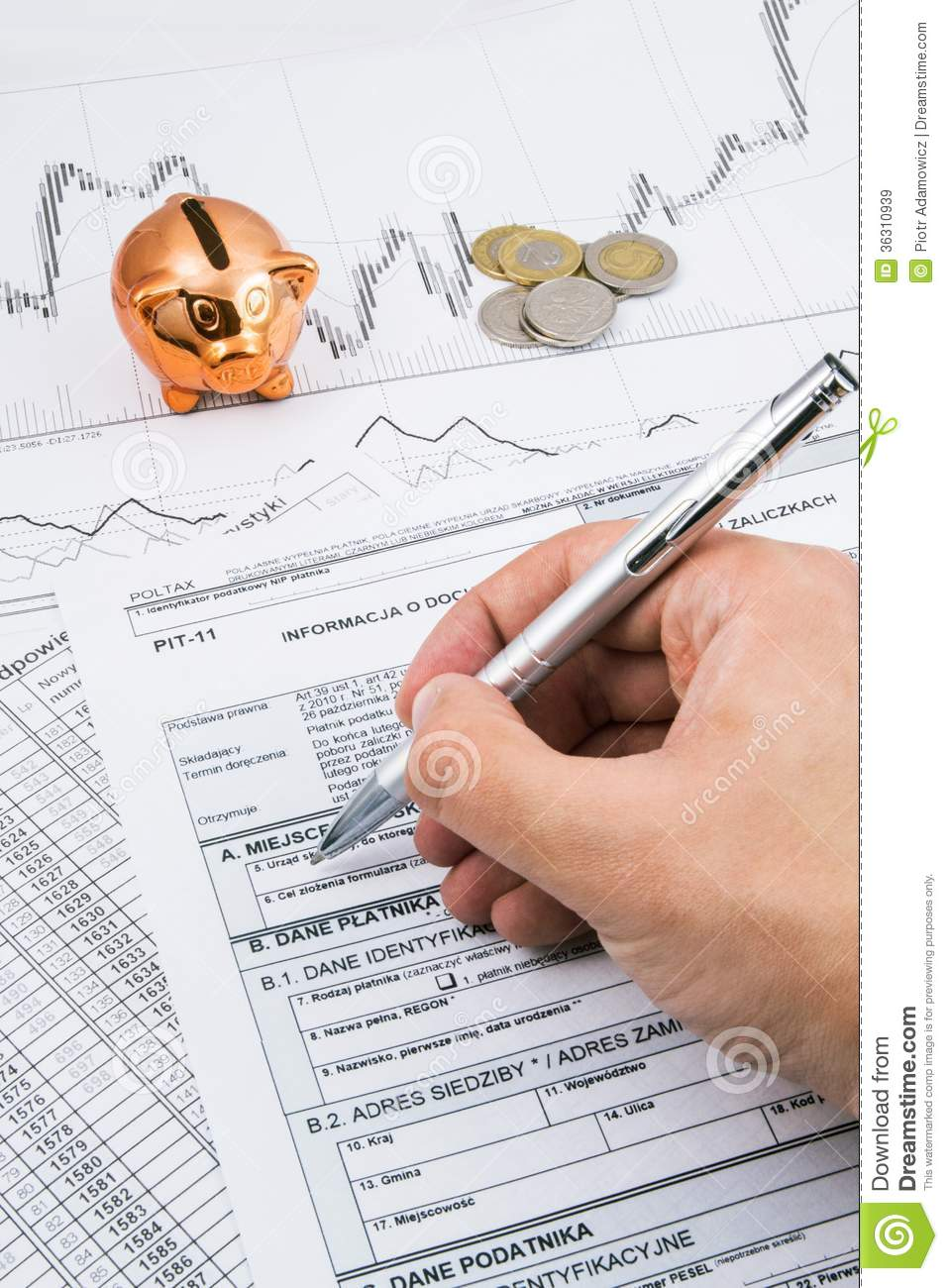 Man hand filling PIT-11 polish income tax forms