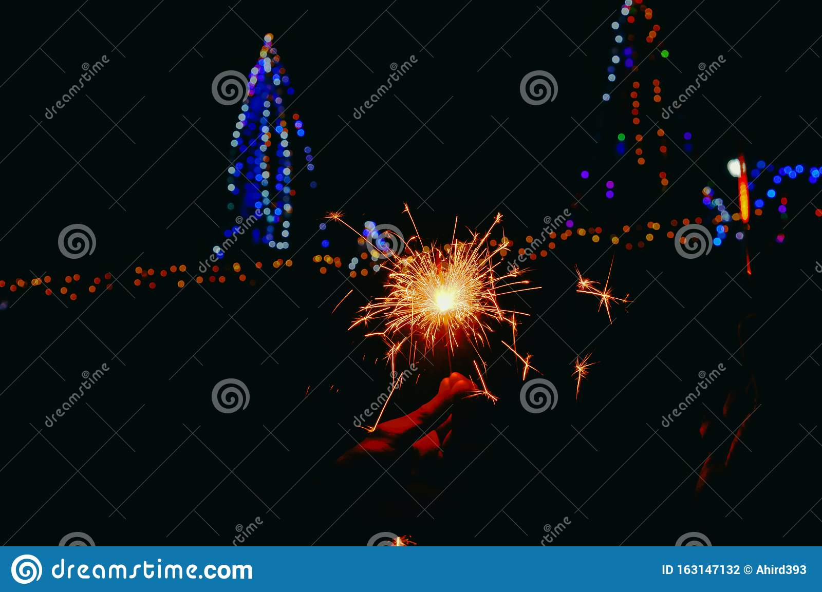 man hand firewrks Close up view,happy birthday, night party ,happy diwali,Man's hand holds sparklers, Happy New Year, Glowing