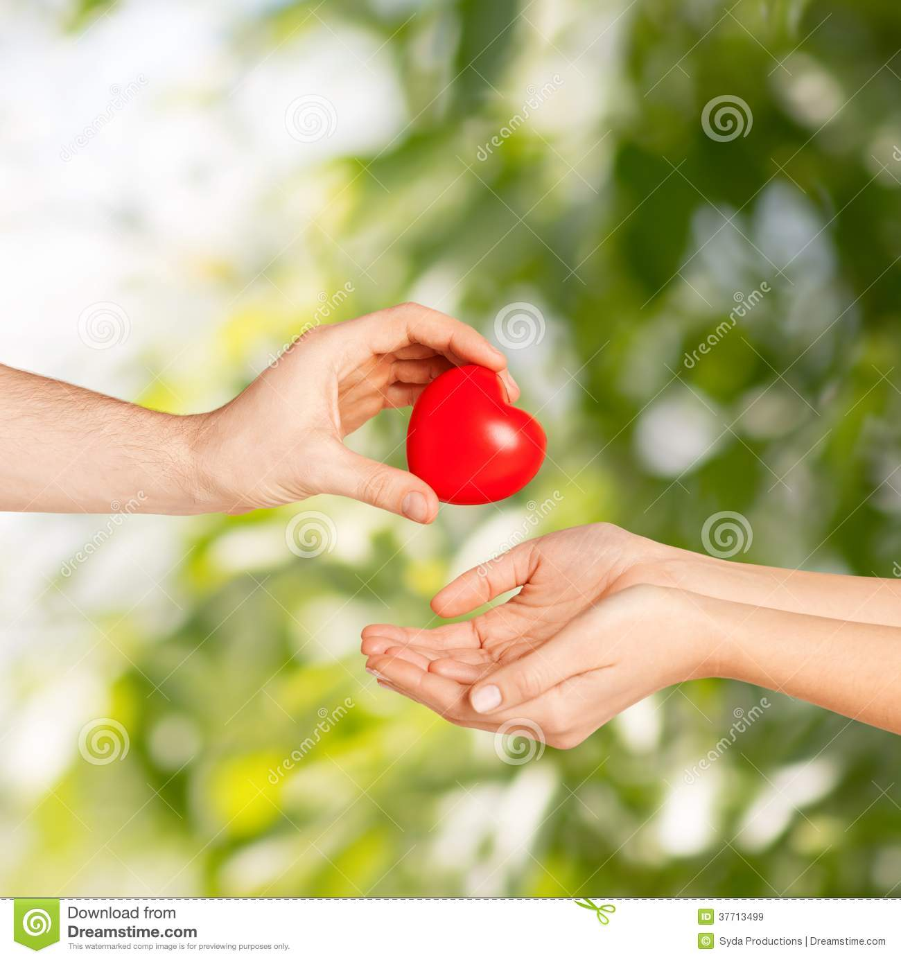 Man Hand Giving Red Heart To Woman Royalty Free Stock