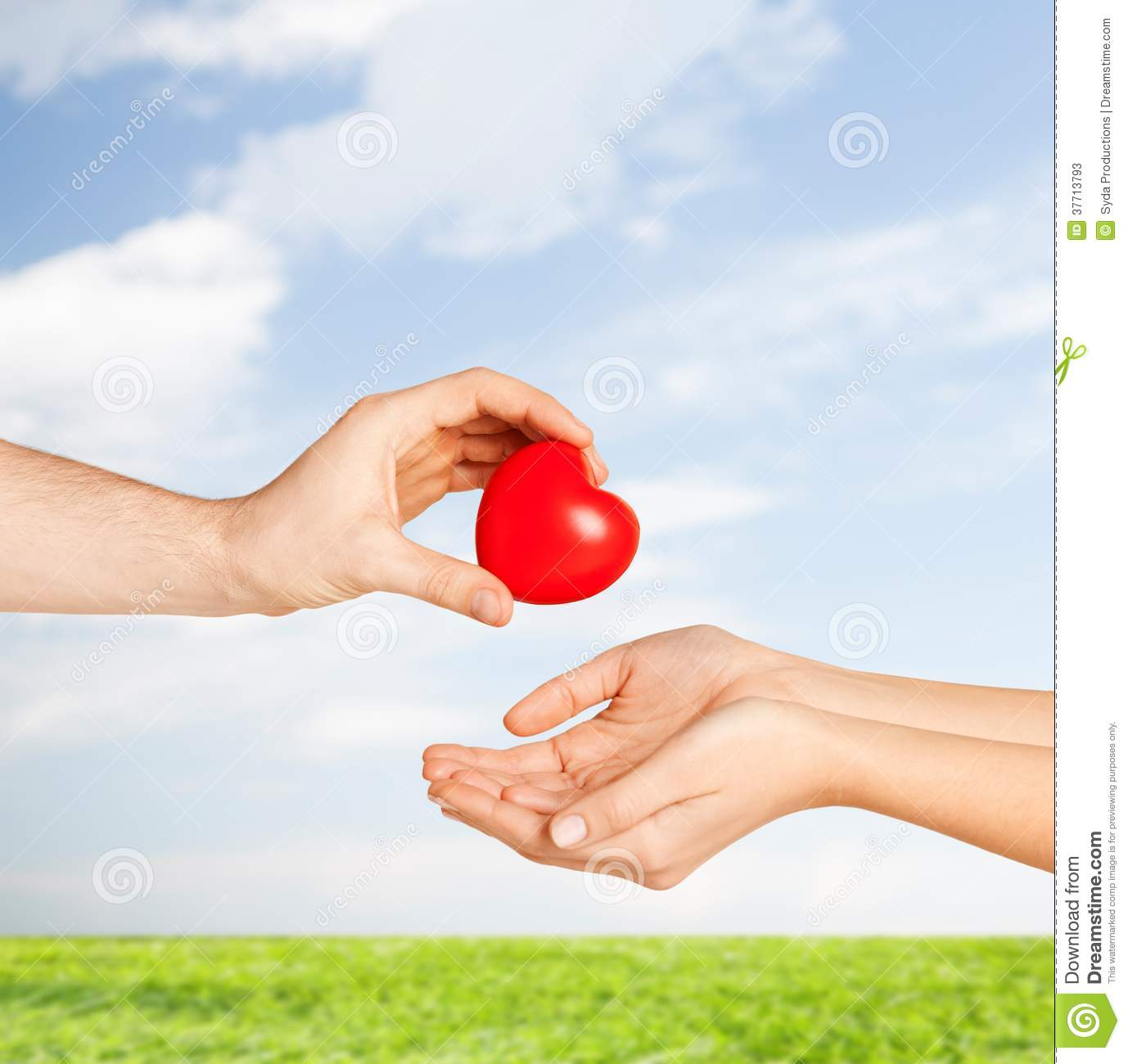 Man Hand Giving Red Heart To Woman Stock Image - Image of