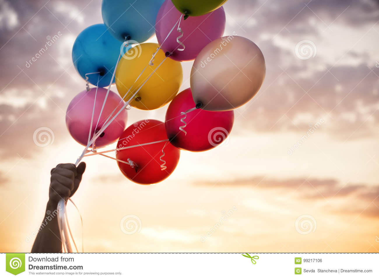 Man Hand Holding Colorful Balloons And A Beautiful Sunset Birthday Party Balloon