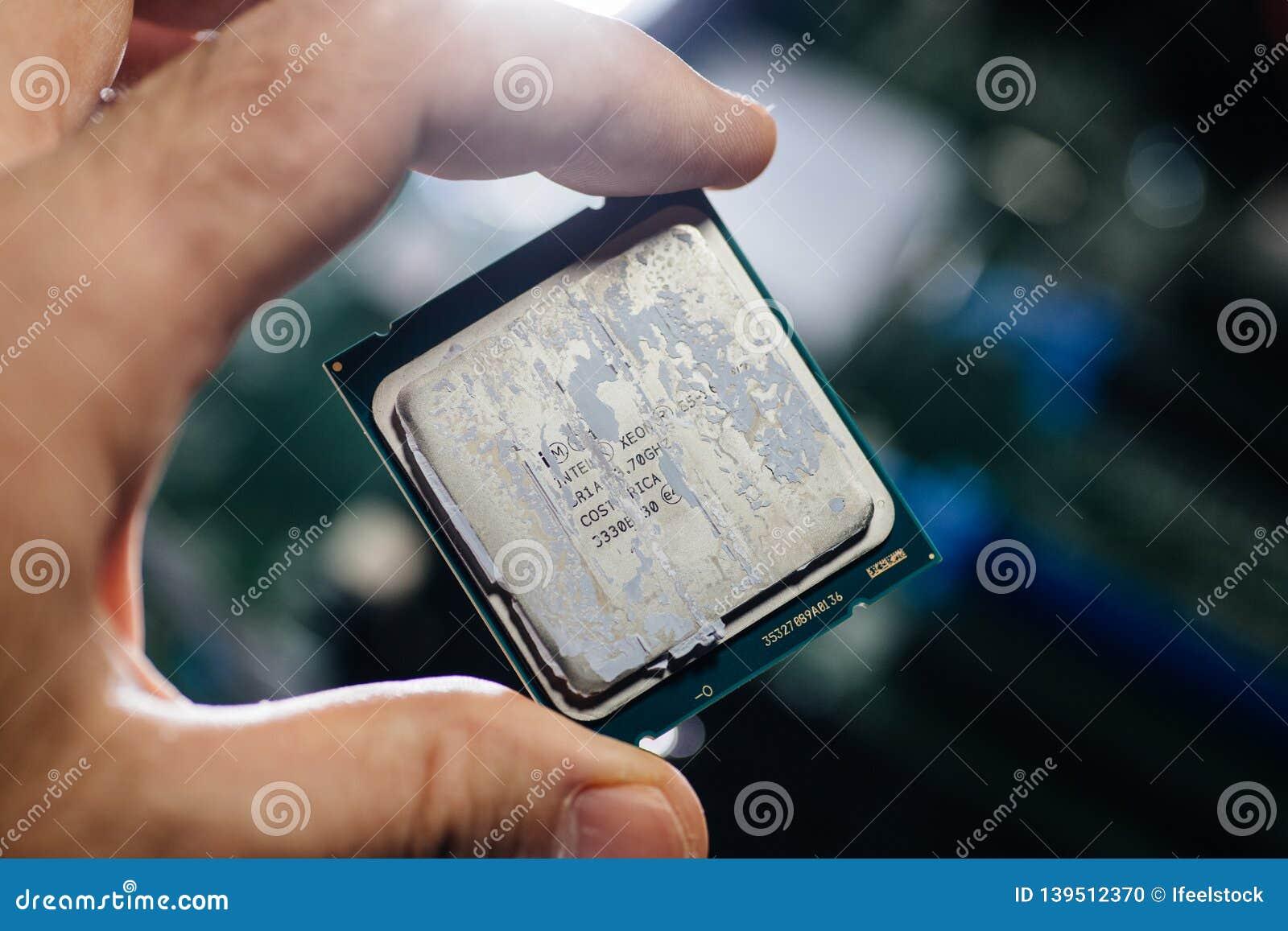 Man Hand Holding Latest Intel Xeon E5-2687w V4 CPU Editorial