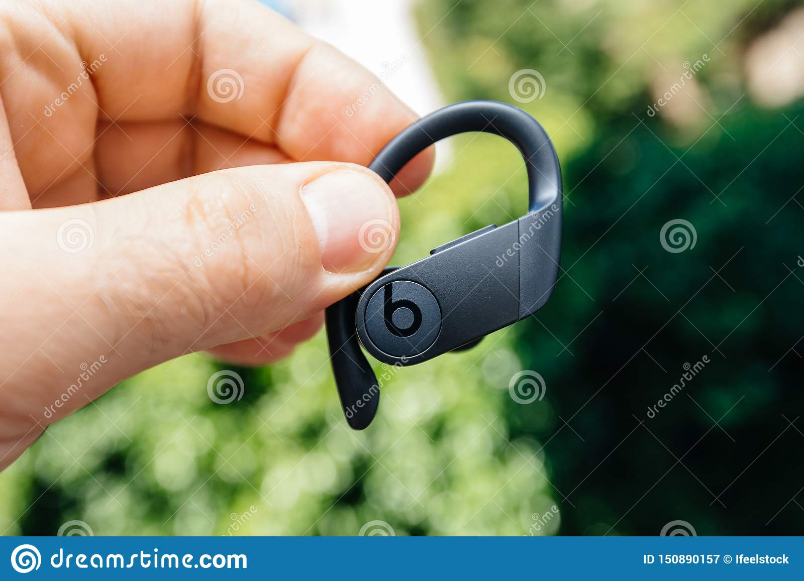 Man hand holding new Powerbeats Pro Beats by Dr Dre
