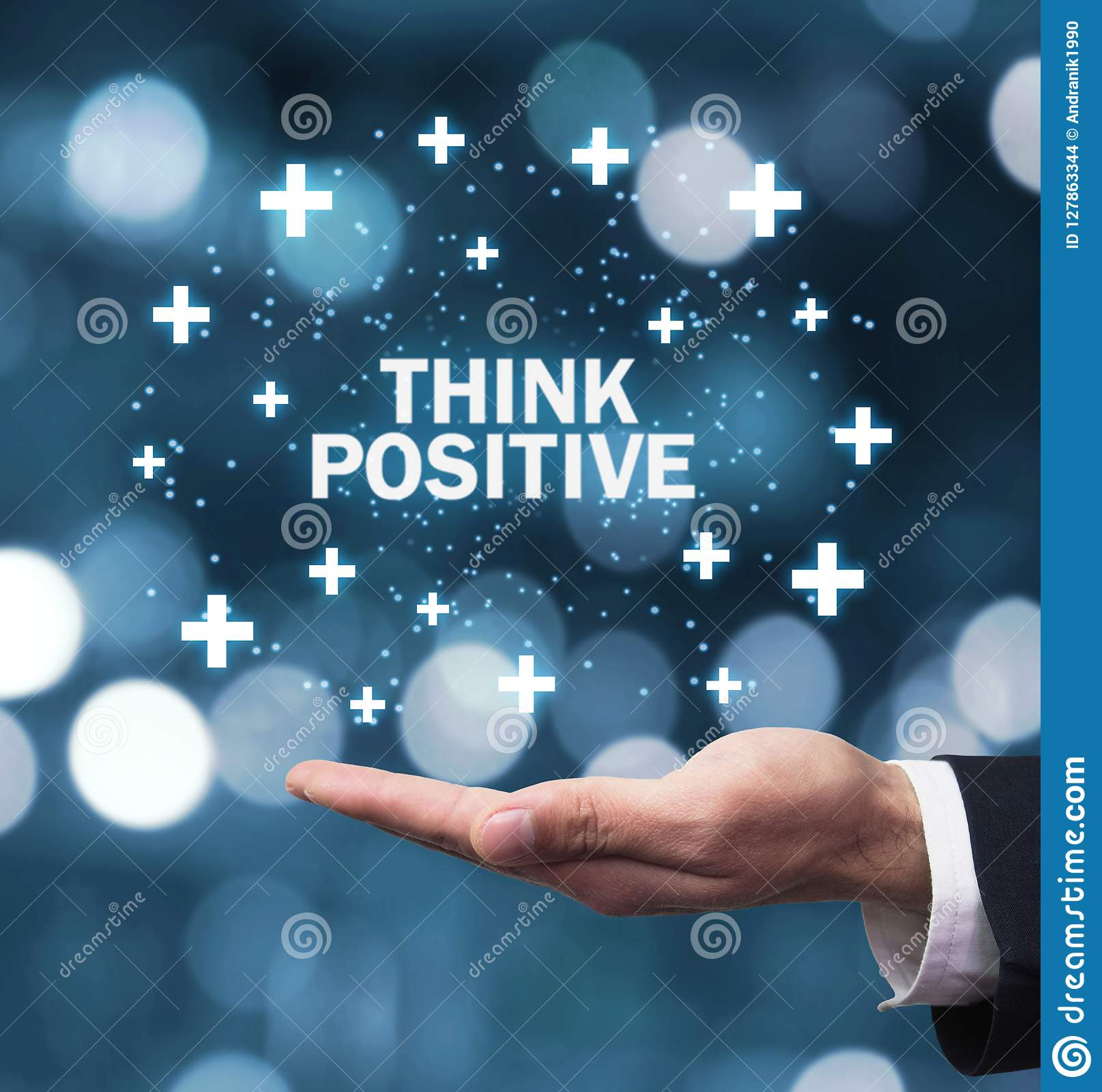 Man hand holding Think Positive words with plus signs.