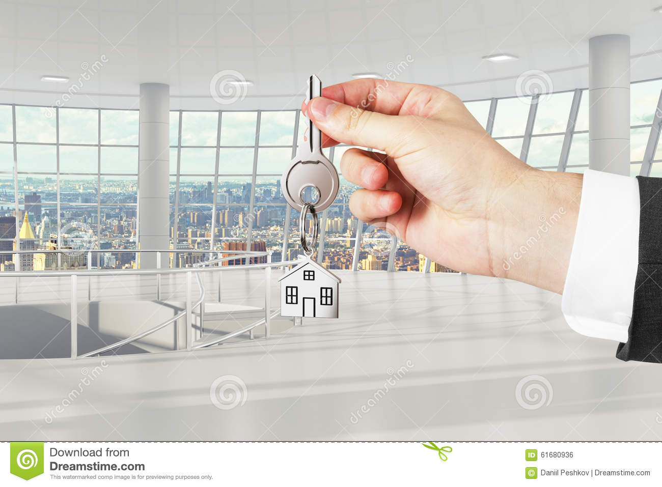 Man hand with keys with light empty office on background