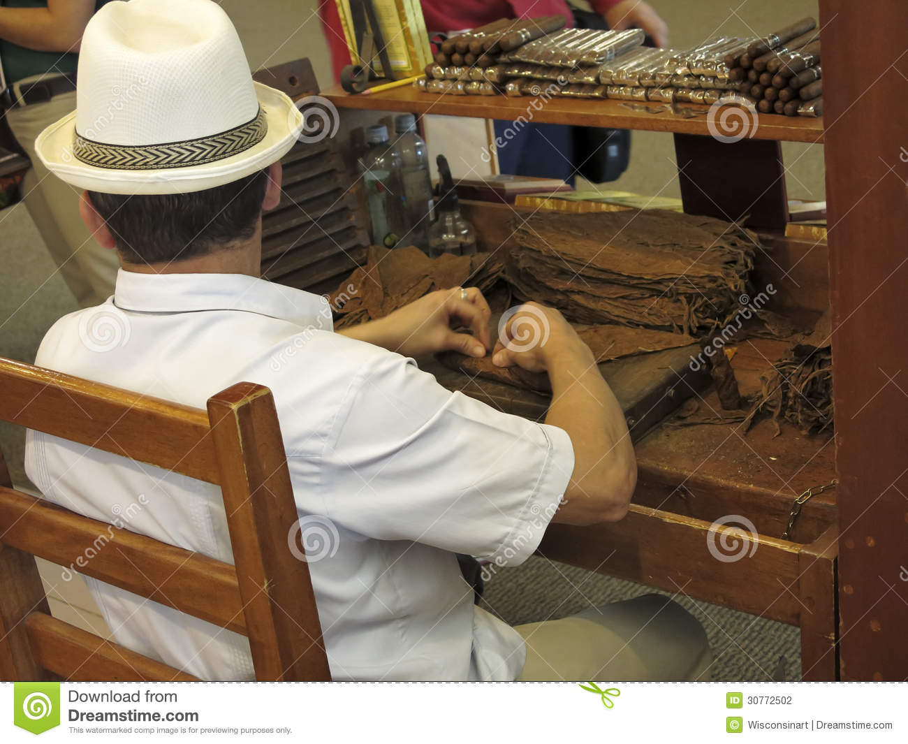 Man Hand Rolling Tobacco To Make Cigars Editorial