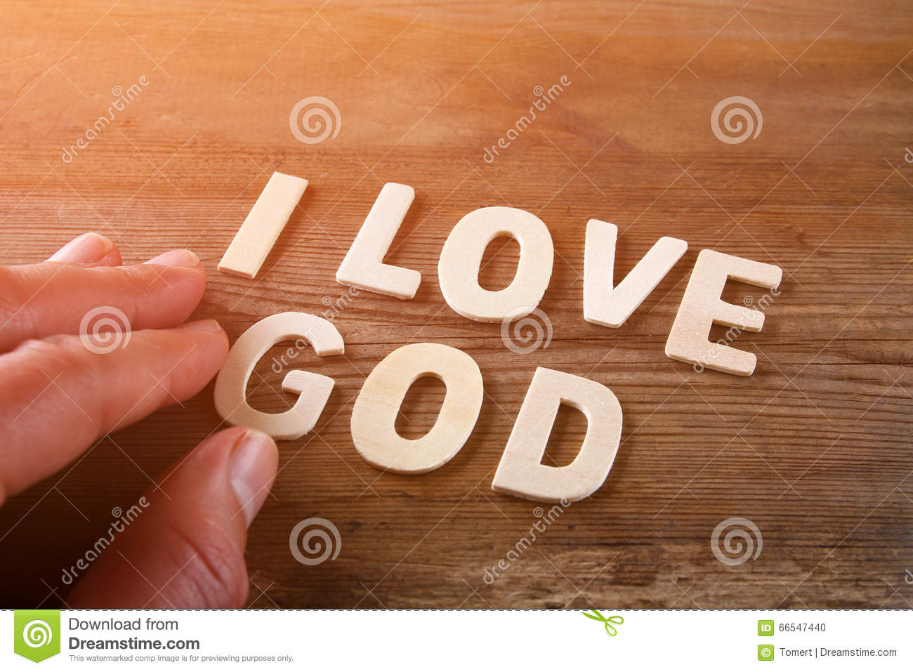 Man Hand Spelling The Word I Love God From Wooden Letters ...