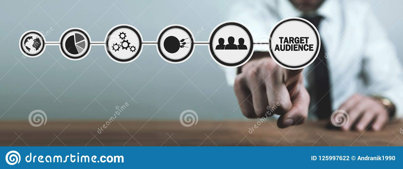 Man hand touching a Target Audience button. Business concept
