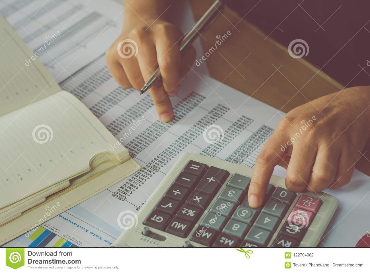 man hand using a financial calculator with writing make note and