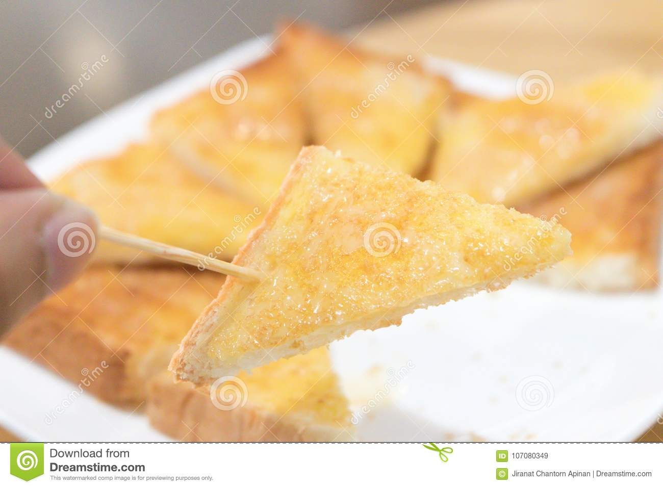 Man Hand Who Are Picking Up The Toast Stock Image