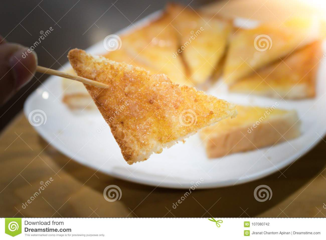 Man Hand Who Are Picking Up The Toast Stock Photo