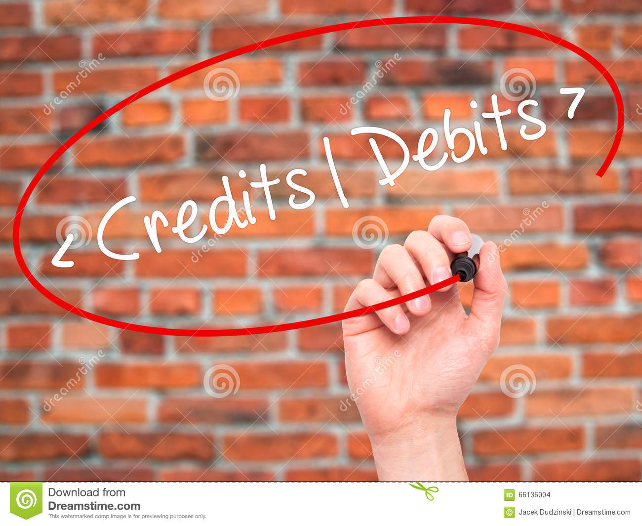 Man Hand writing Credits - Debits with black marker on visual sc