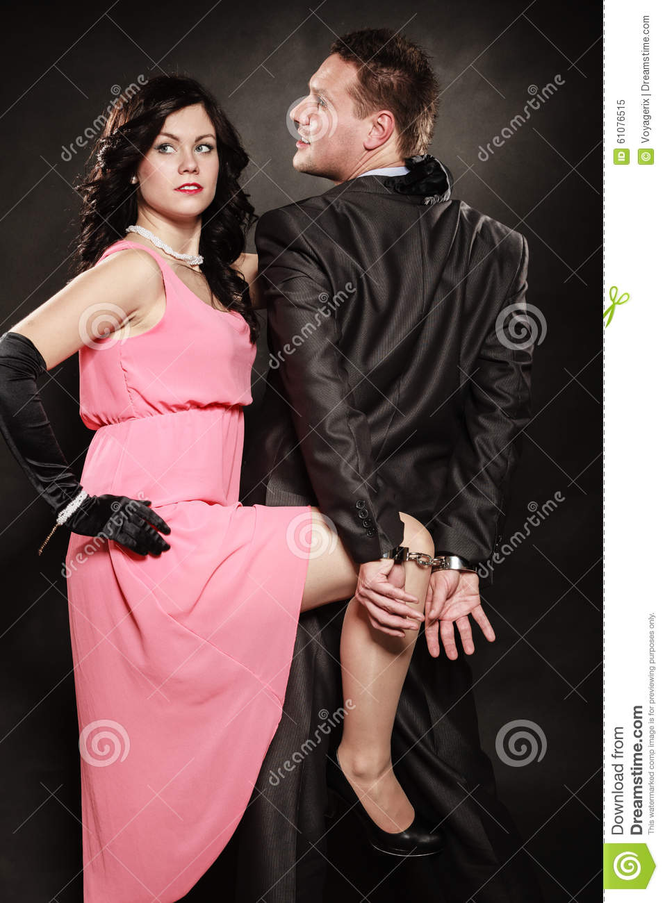 Man In Handcuffs And Woman Detective Spy. Stock Image - Image of ...