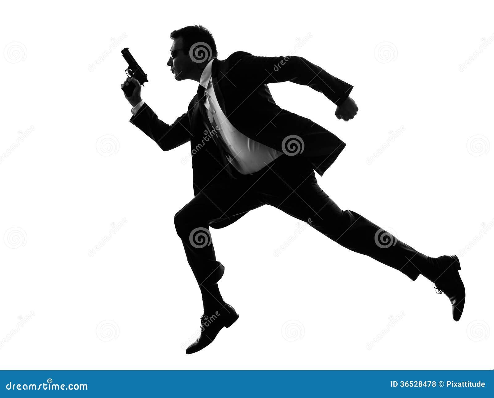 Running Man In Suit Silhouette Man With Handgun Runni...