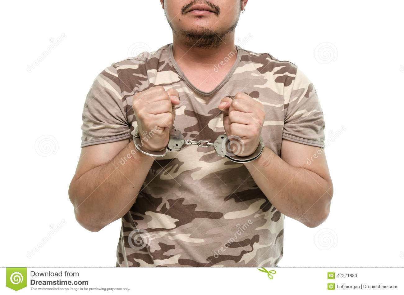 Man hands with handcuffs showing victory sign