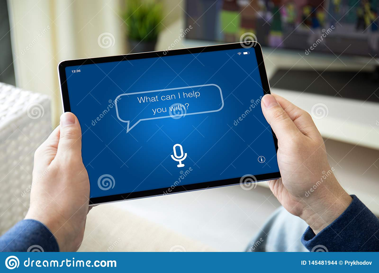 Man hands holding computer tablet with app personal assistant