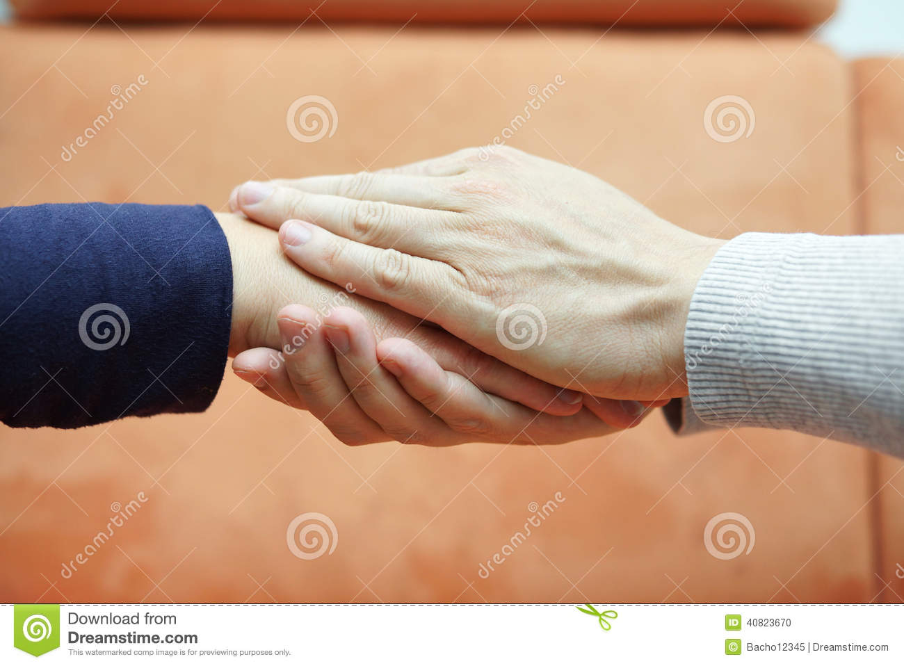 Man hands holding woman hand from both sides. Compassion