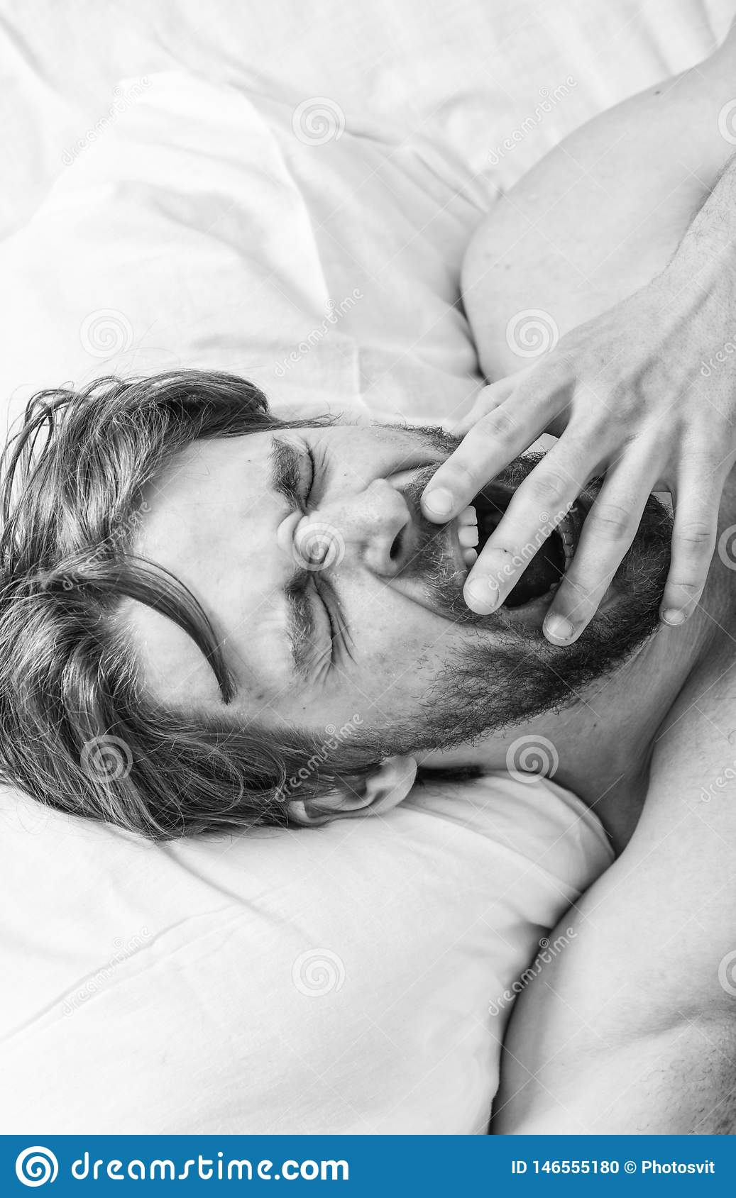 Man handsome guy lay in bed. Get adequate and consistent amount of sleep every night. How much sleep you actually need