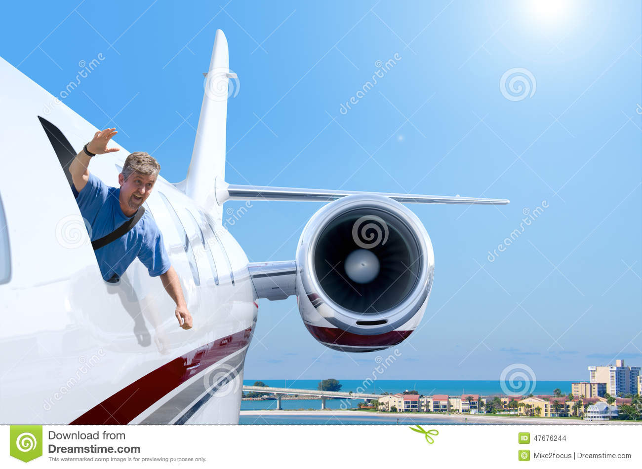Man hanging out flying airplane window stock photo image 47676244