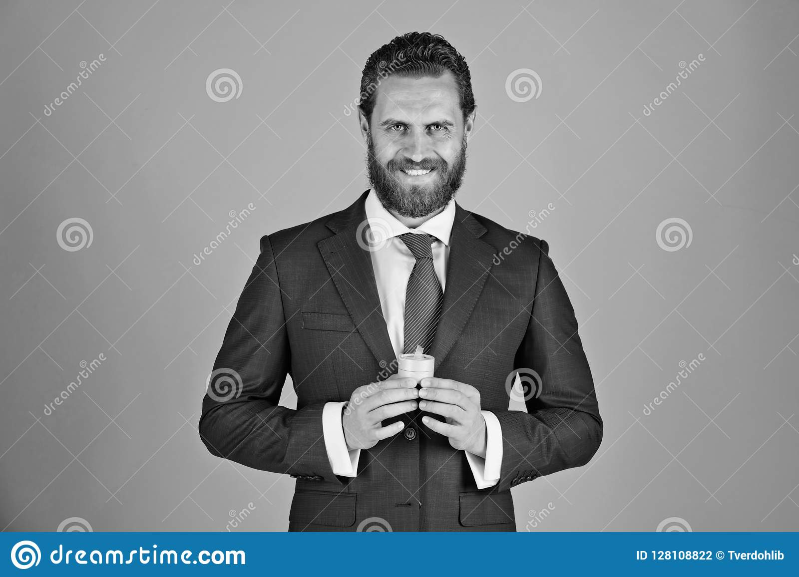 Man or happy bride groom with gift box for jewelry