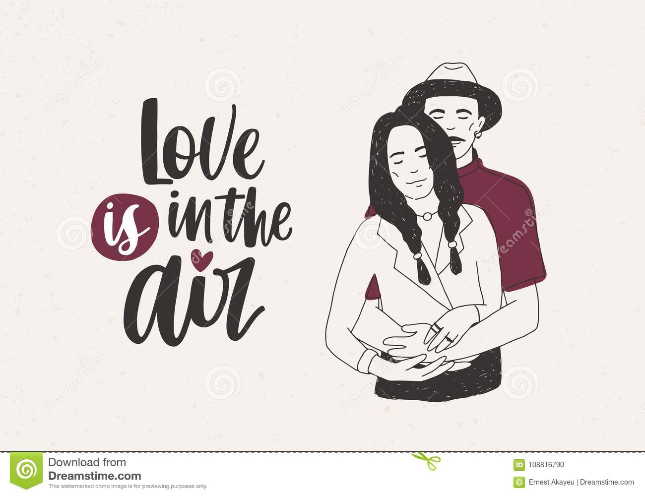 Man in hat standing behind woman with braids and embracing her and Love Is In The Air lettering on light background