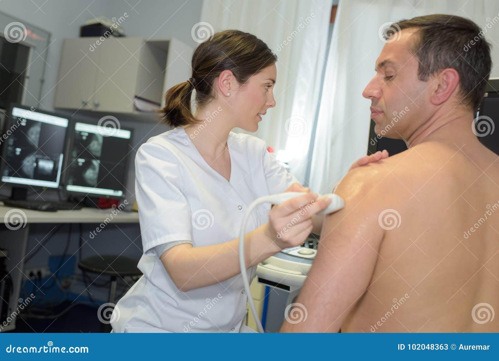 Man having ultrasound on shoulder