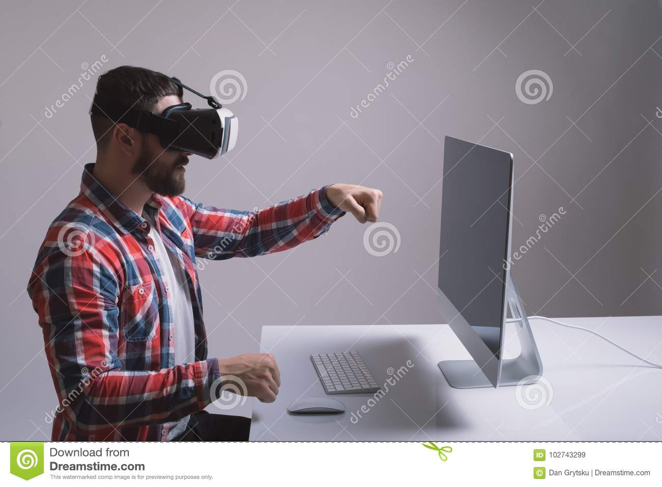 d4aa29de1c0 Man in helmet virtual reality plays game. Man uses VR-headset display with  headphones for virtual reality game in office. High-tech devices.
