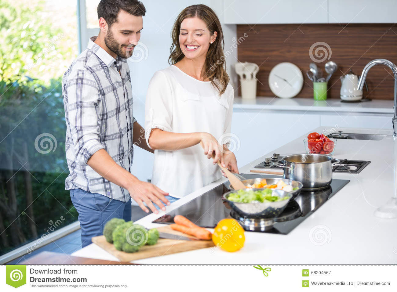 Man Helping Woman In Cooking Food Stock Photo - Image ...
