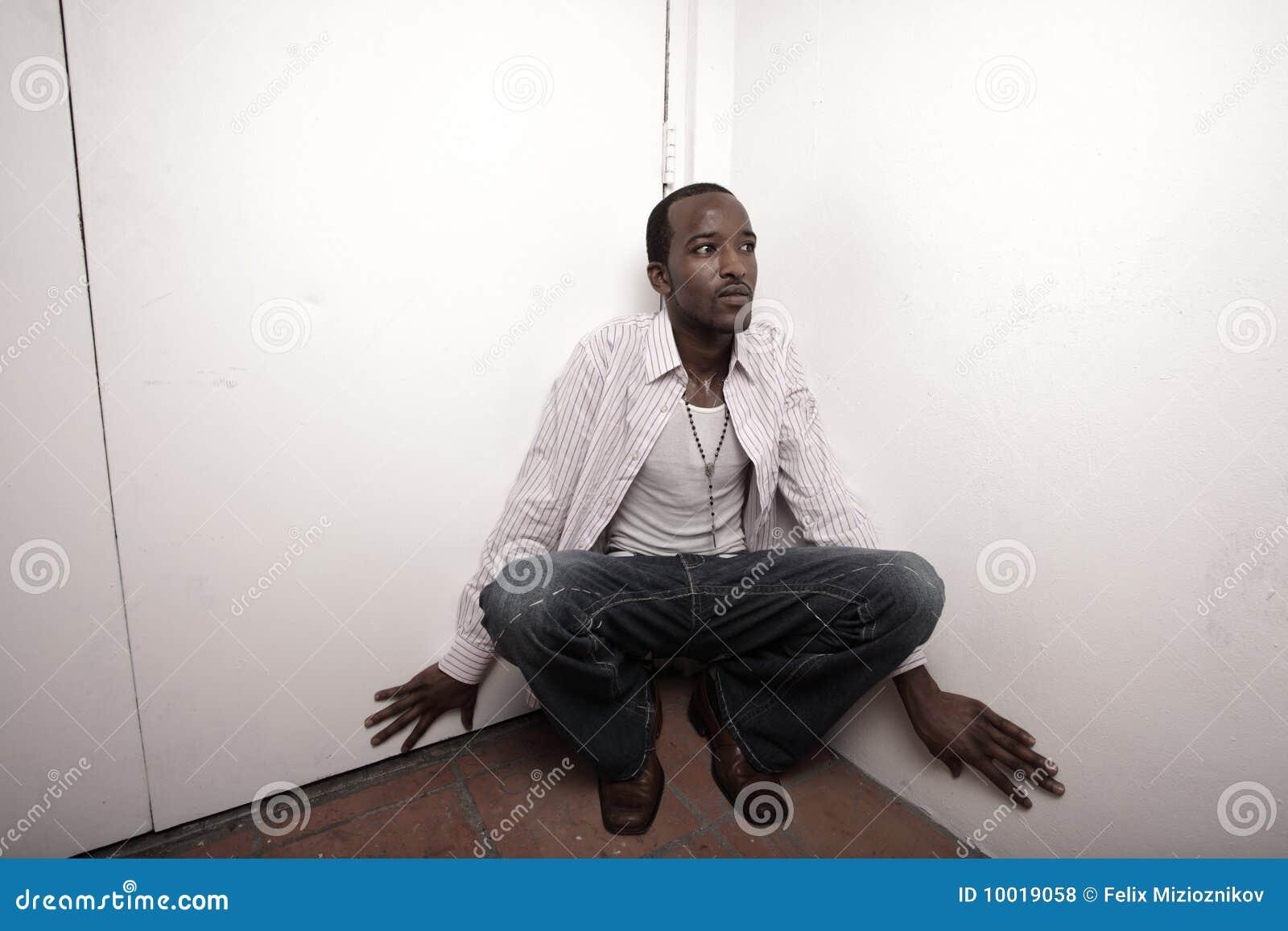 Man Hiding In The Corner Royalty Free Stock Photos