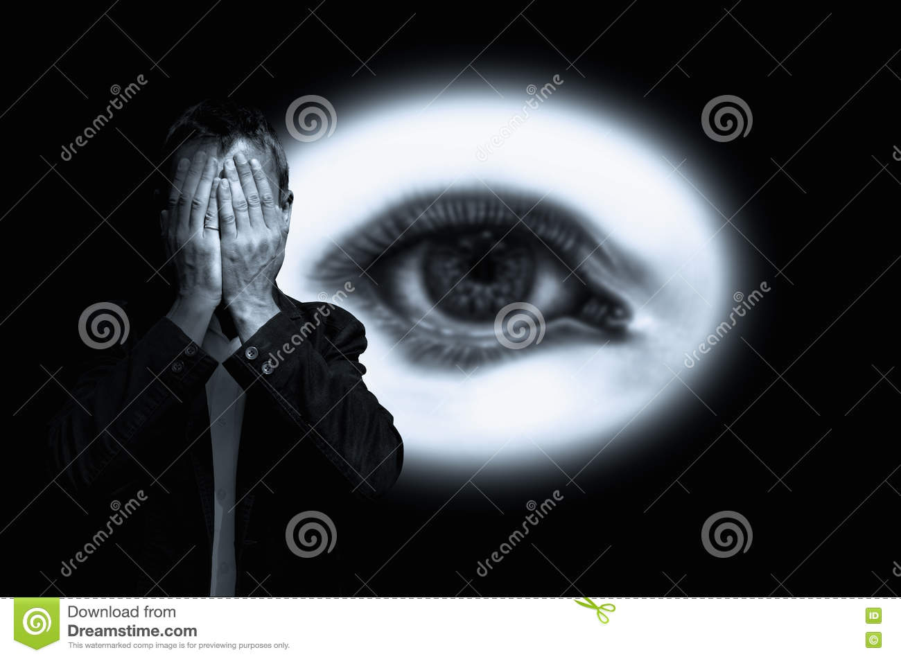 Man hiding his face on background with eye in white circle.