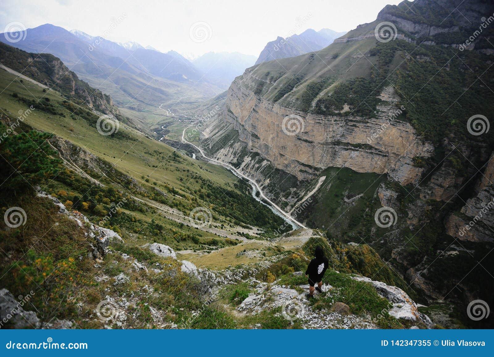Man in high Caucasus Mountains