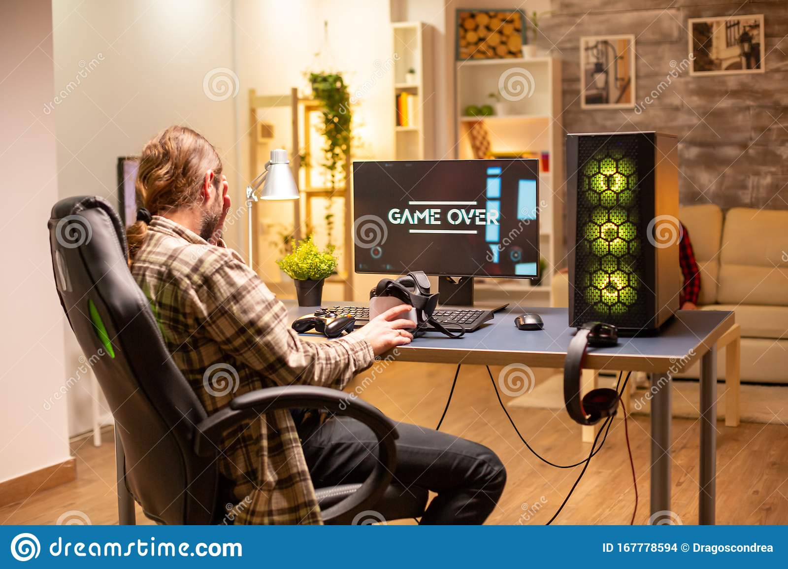 Man On His Powerful Pc Computer In The Living Room Late At Night Loosing A Game Stock Photo Image Of Esport Headphones 167778594