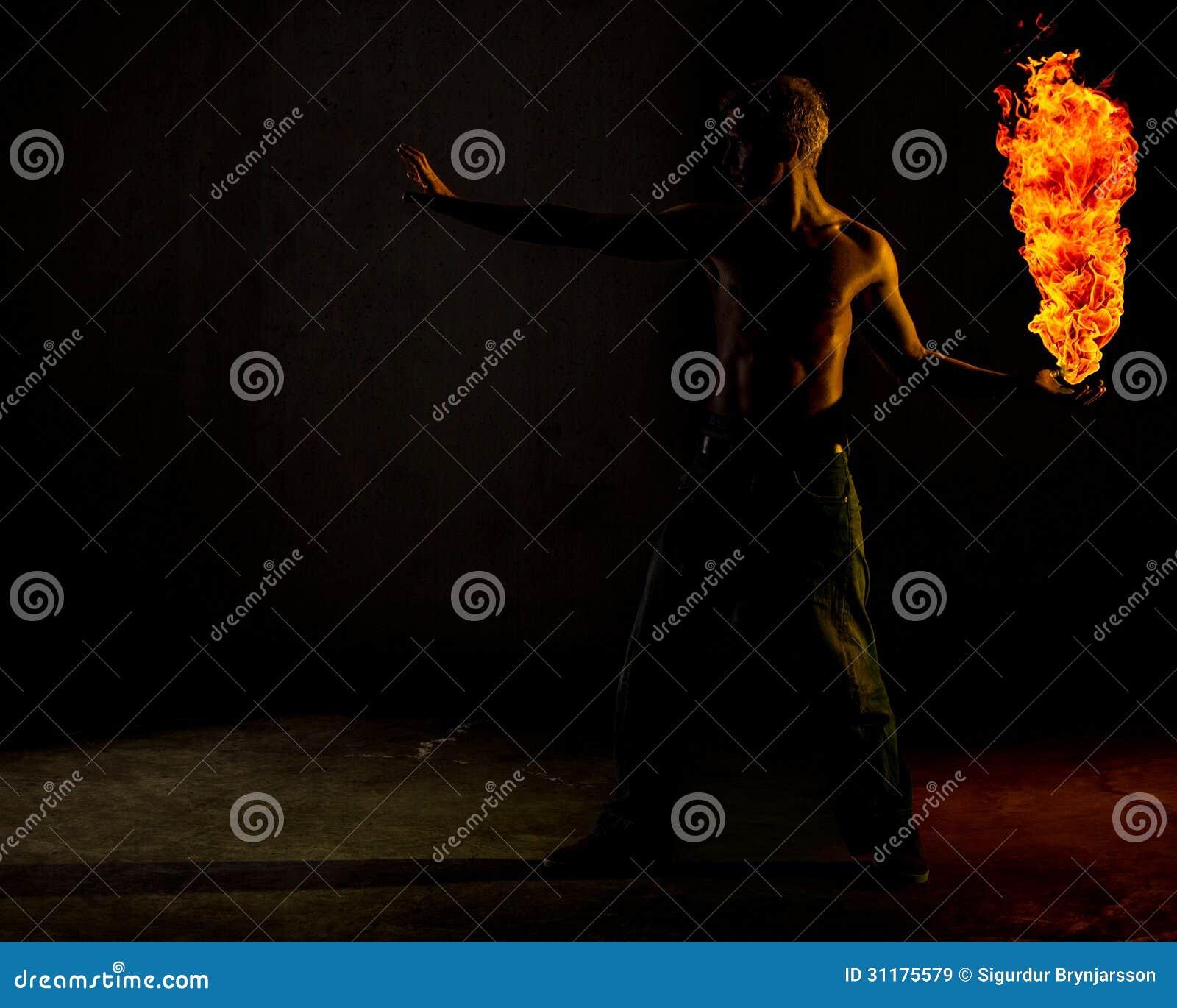 A man holding a ball of fire