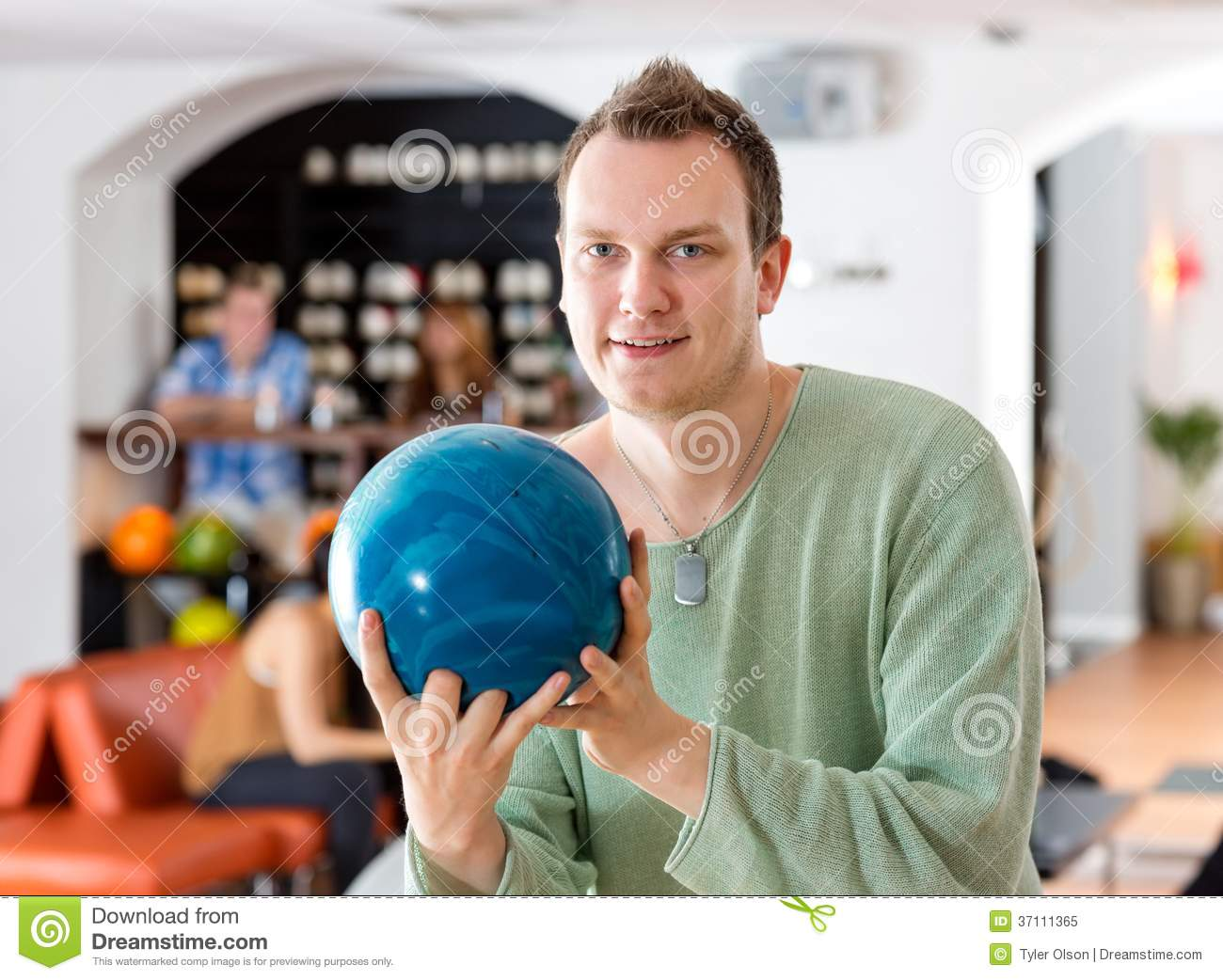 Man Holding Blue Bowling Ball In Club Royalty Free Stock ...