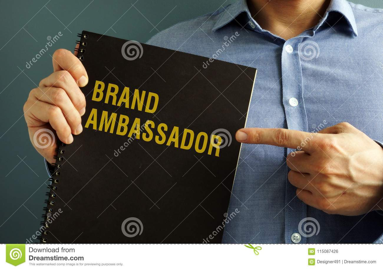 Man holding book with title Brand Ambassador.