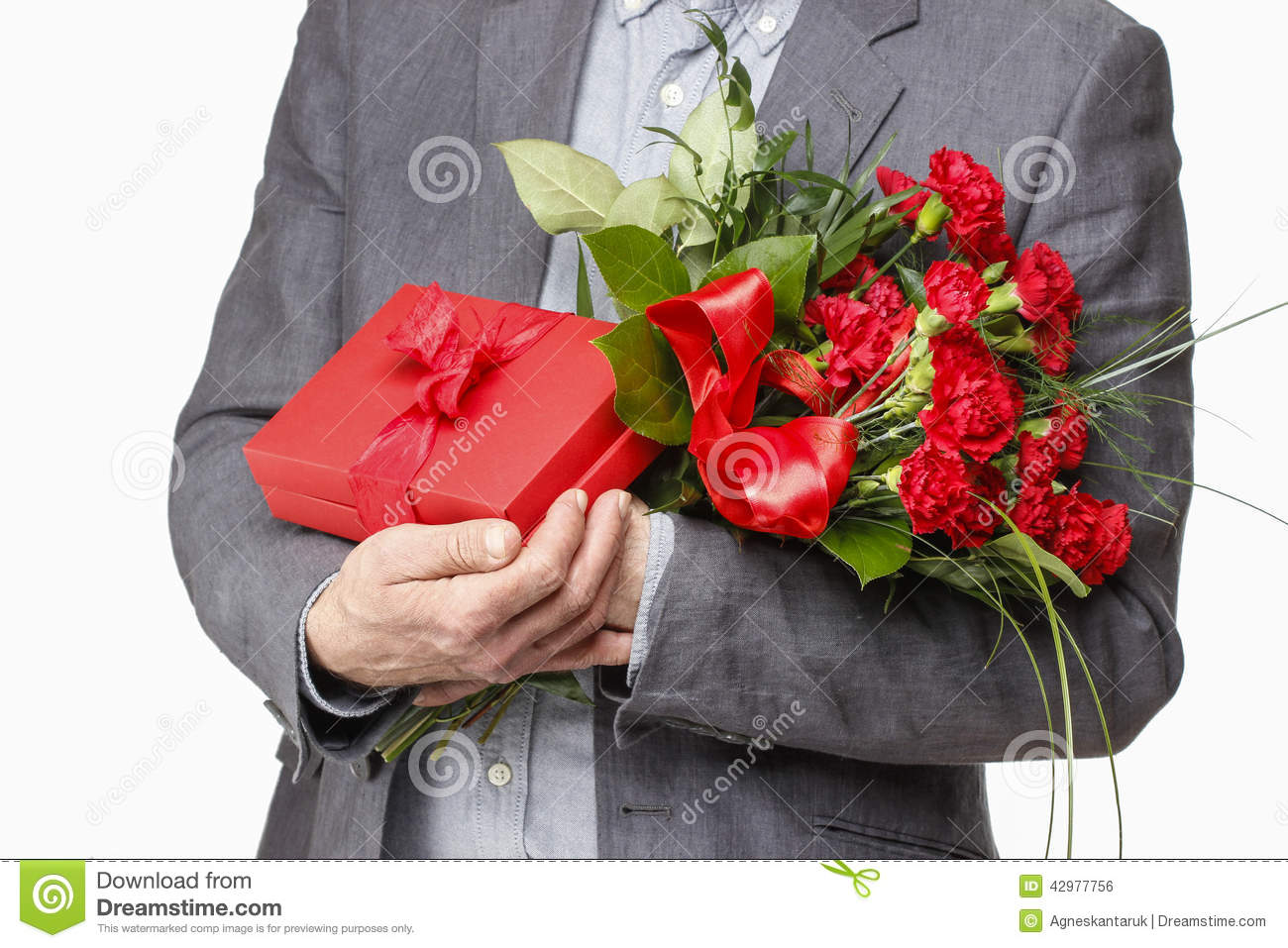 Man Holding Bouquet Of Carnation Flowers And Red Box With