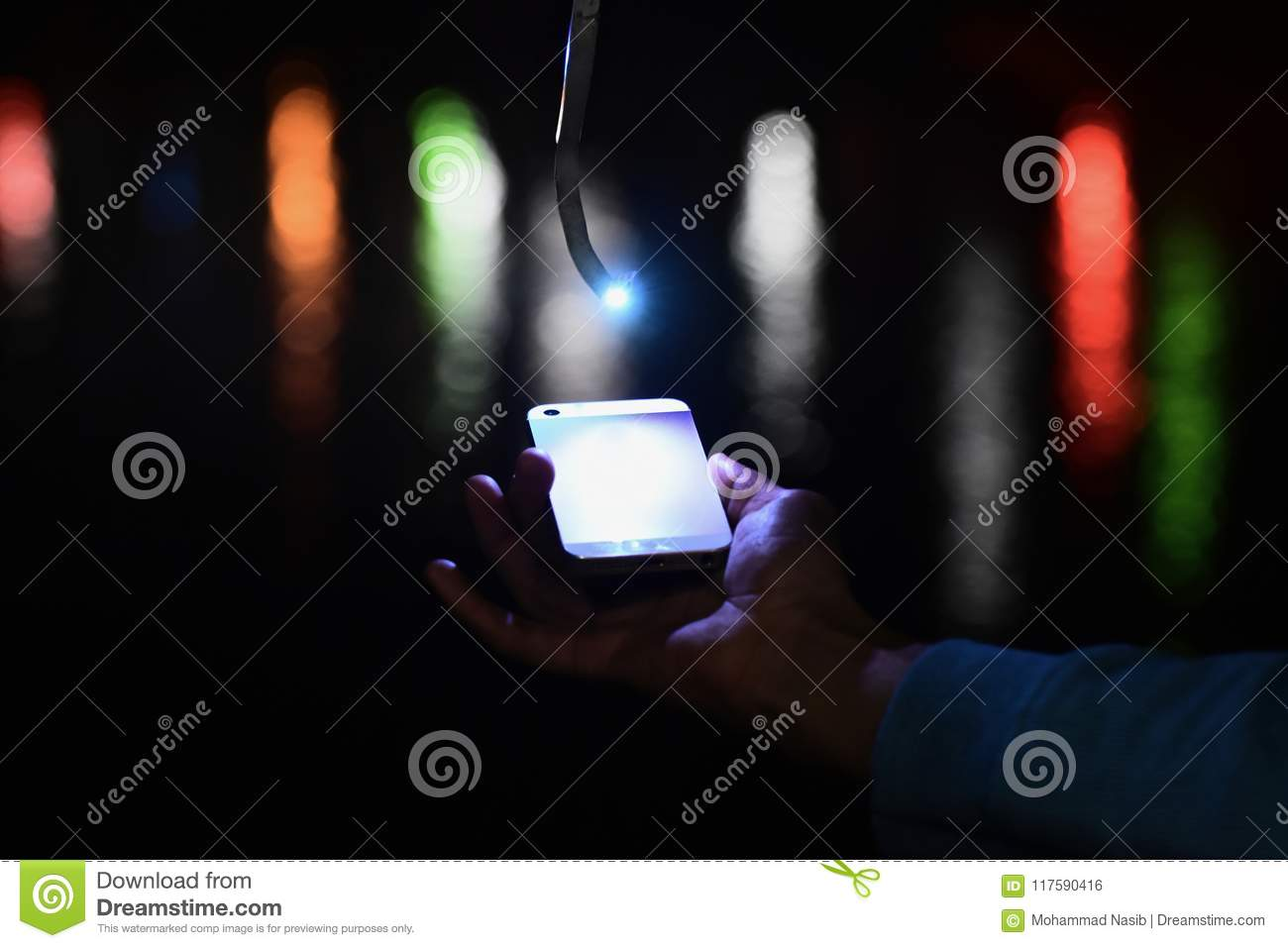 Download Man Holding An Smart Phone In Hand With Blurred Background Photograph Stock Photo - Image of blurred, photograph: 117590416