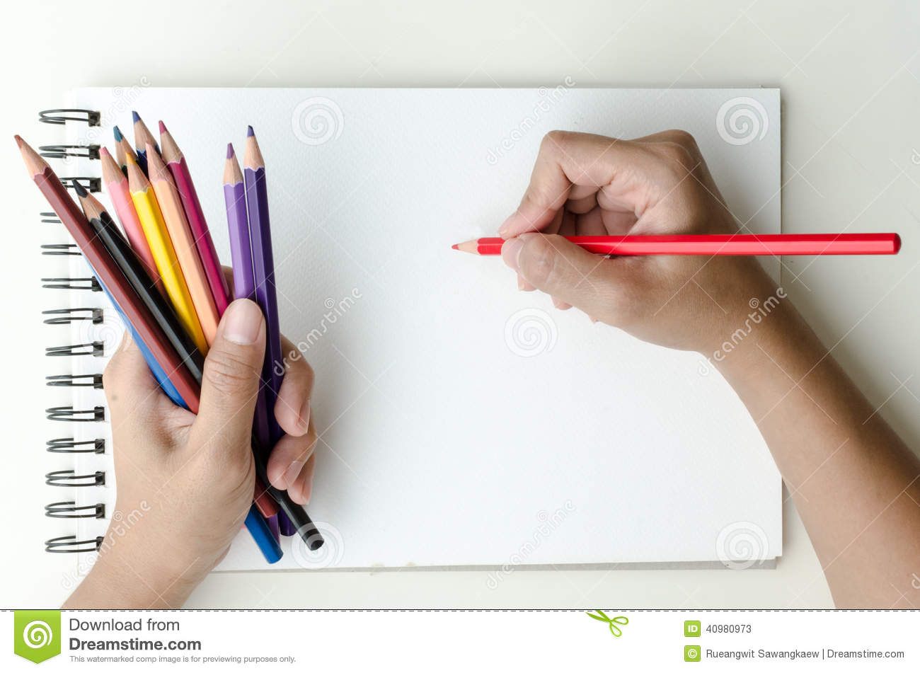 Man Holding Colored Pencils And Sketching Stock Photo