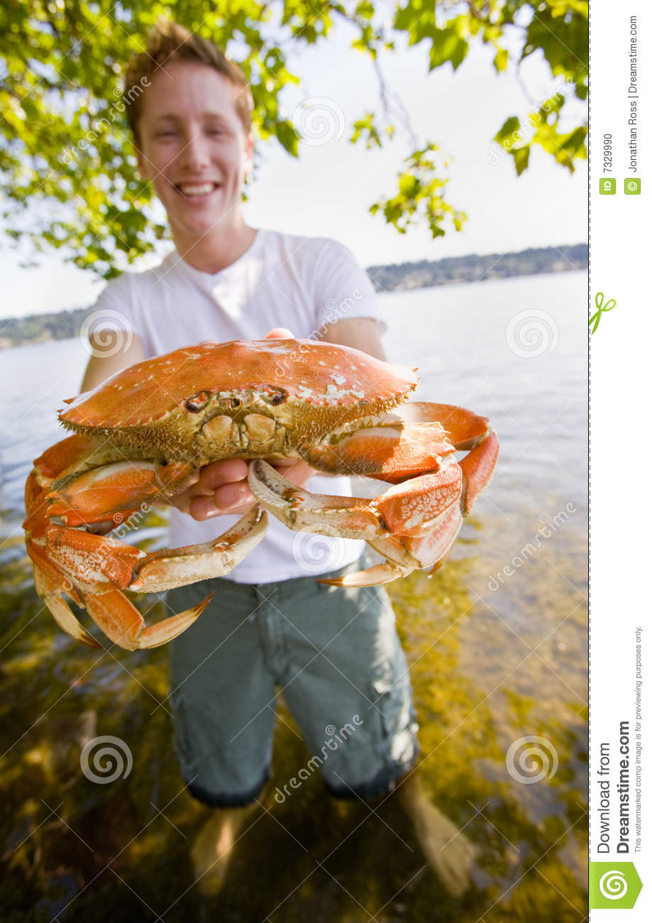 Man Holding Crab Stock...