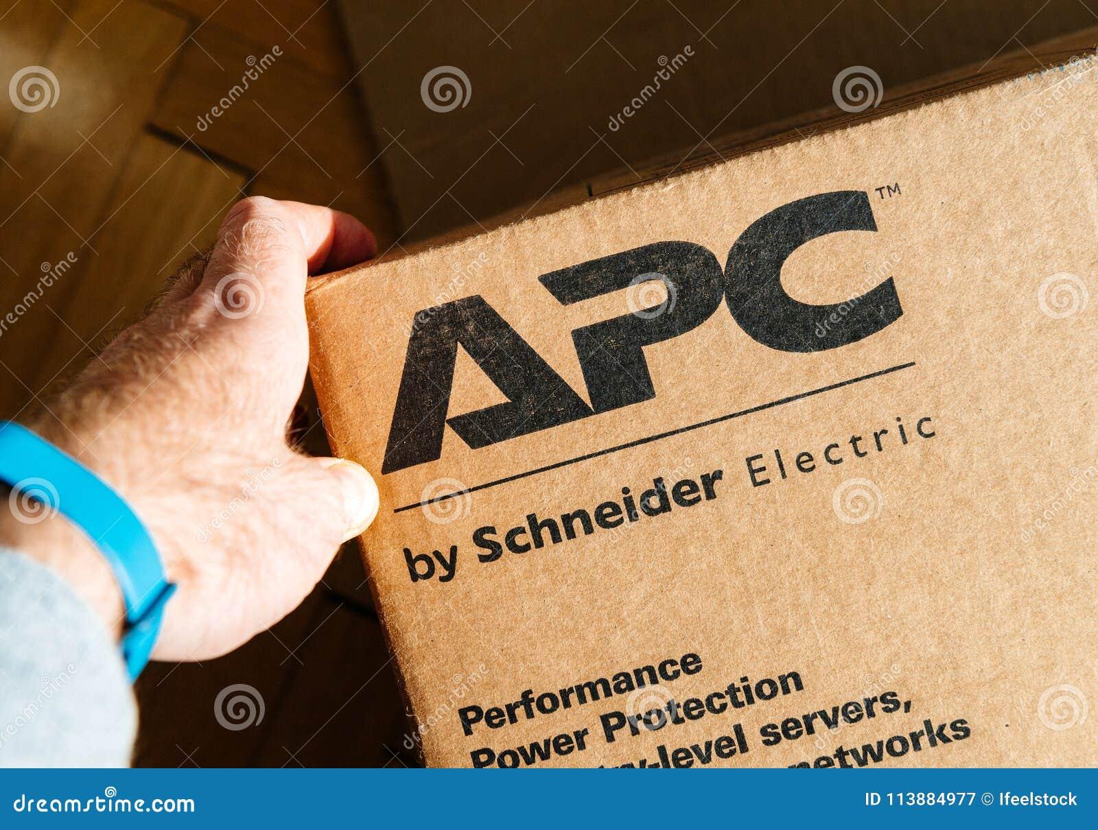 Man Holding Hand Near The Logo Of APC Smart-UPS C Enterprise