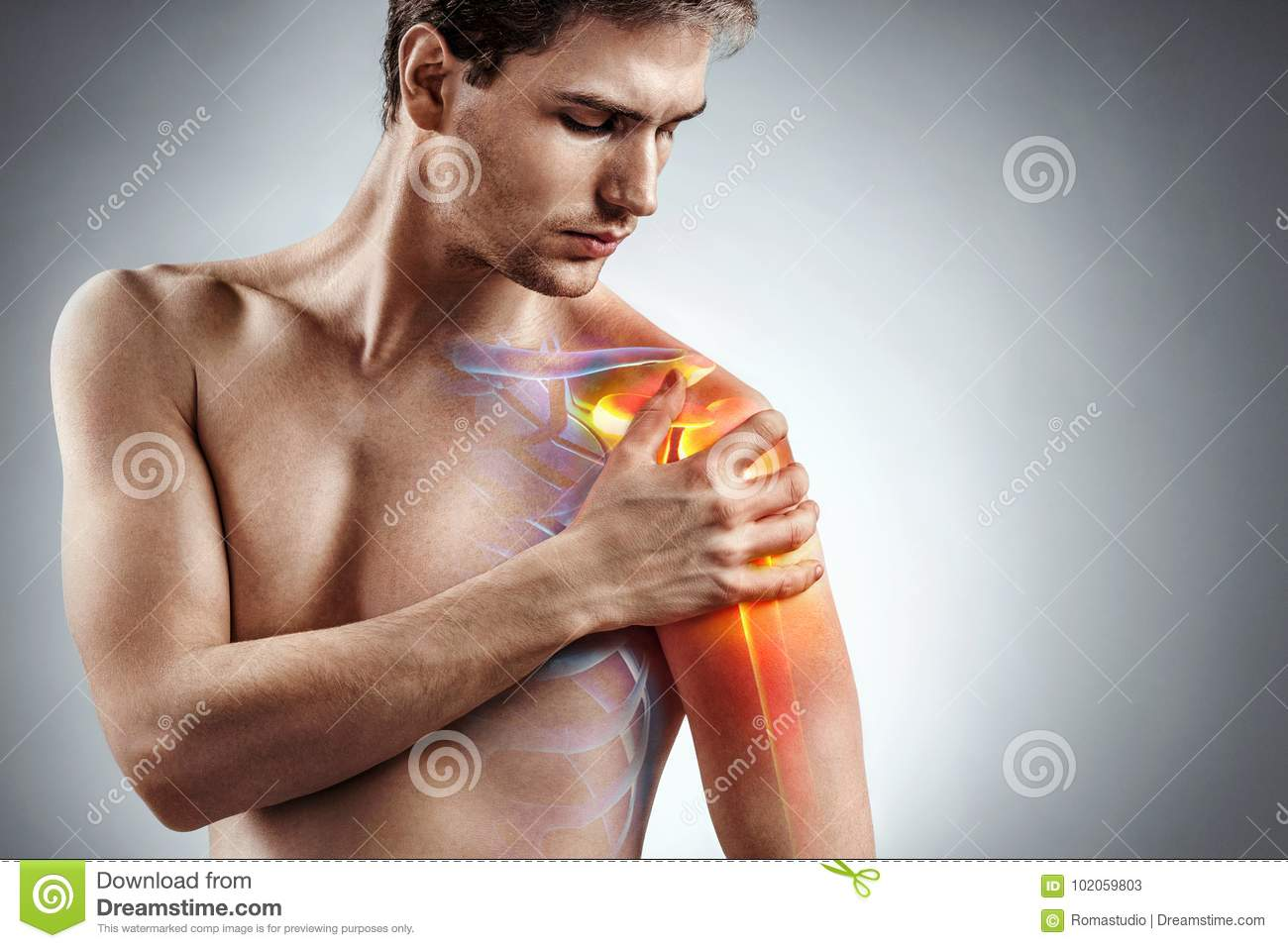 Man holding his injured shoulder that`s highlighted in red.