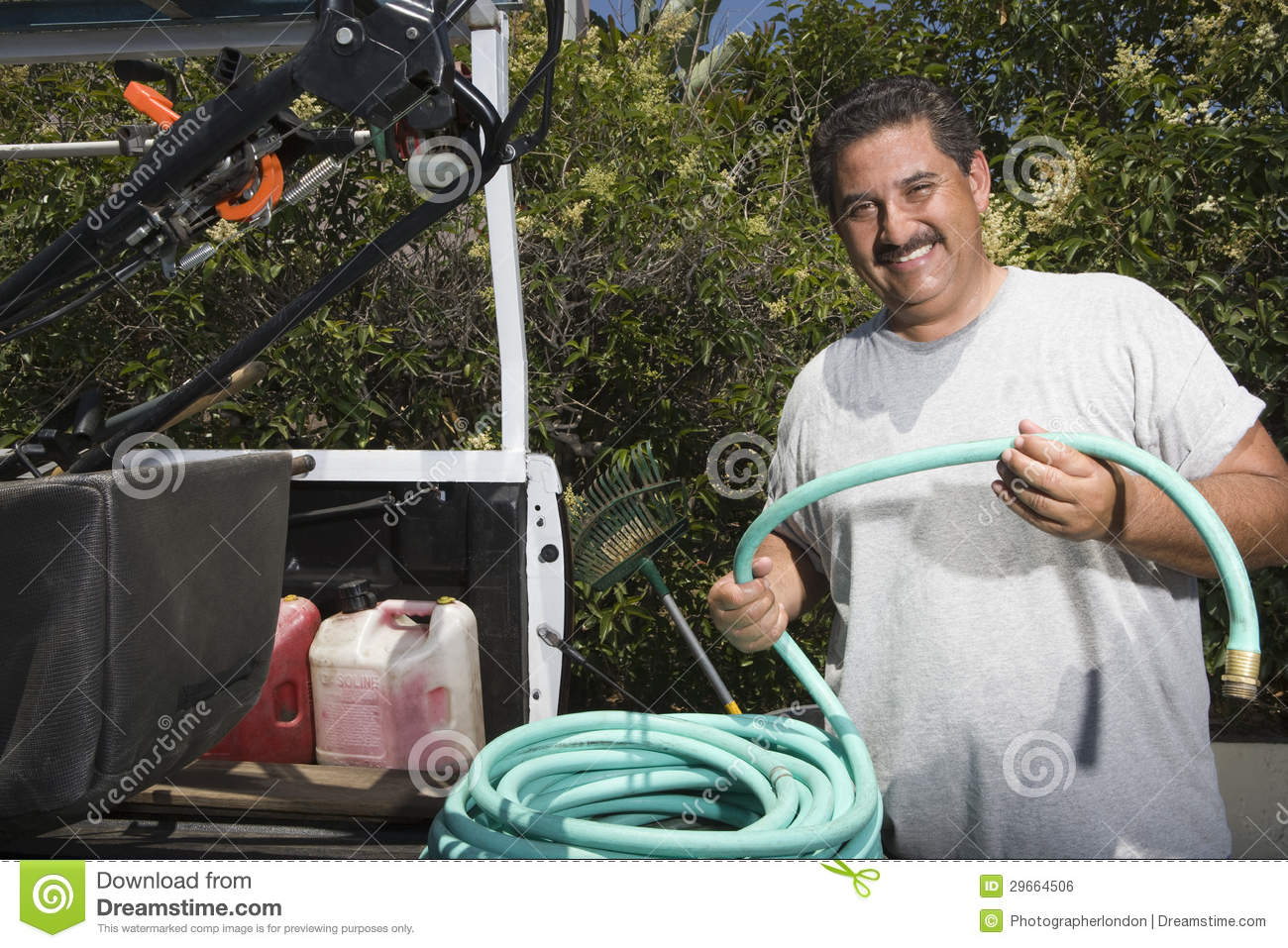 Naked male with garden hose