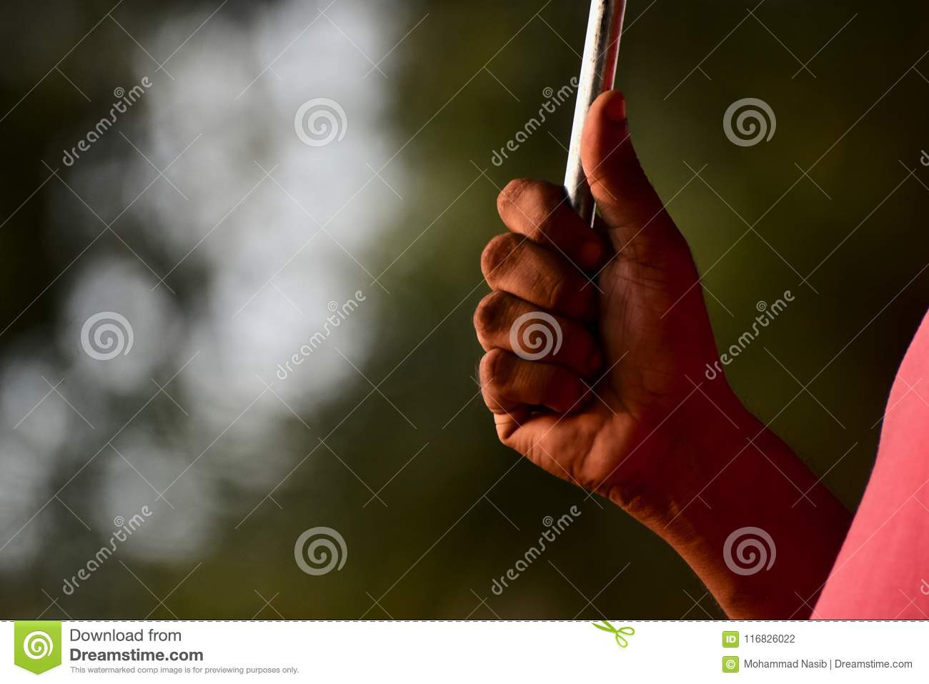 Download Man Holding A Metallic Umbrella In Hand Isolated Unique Photograph Stock Photo - Image of steel, human: 116826022