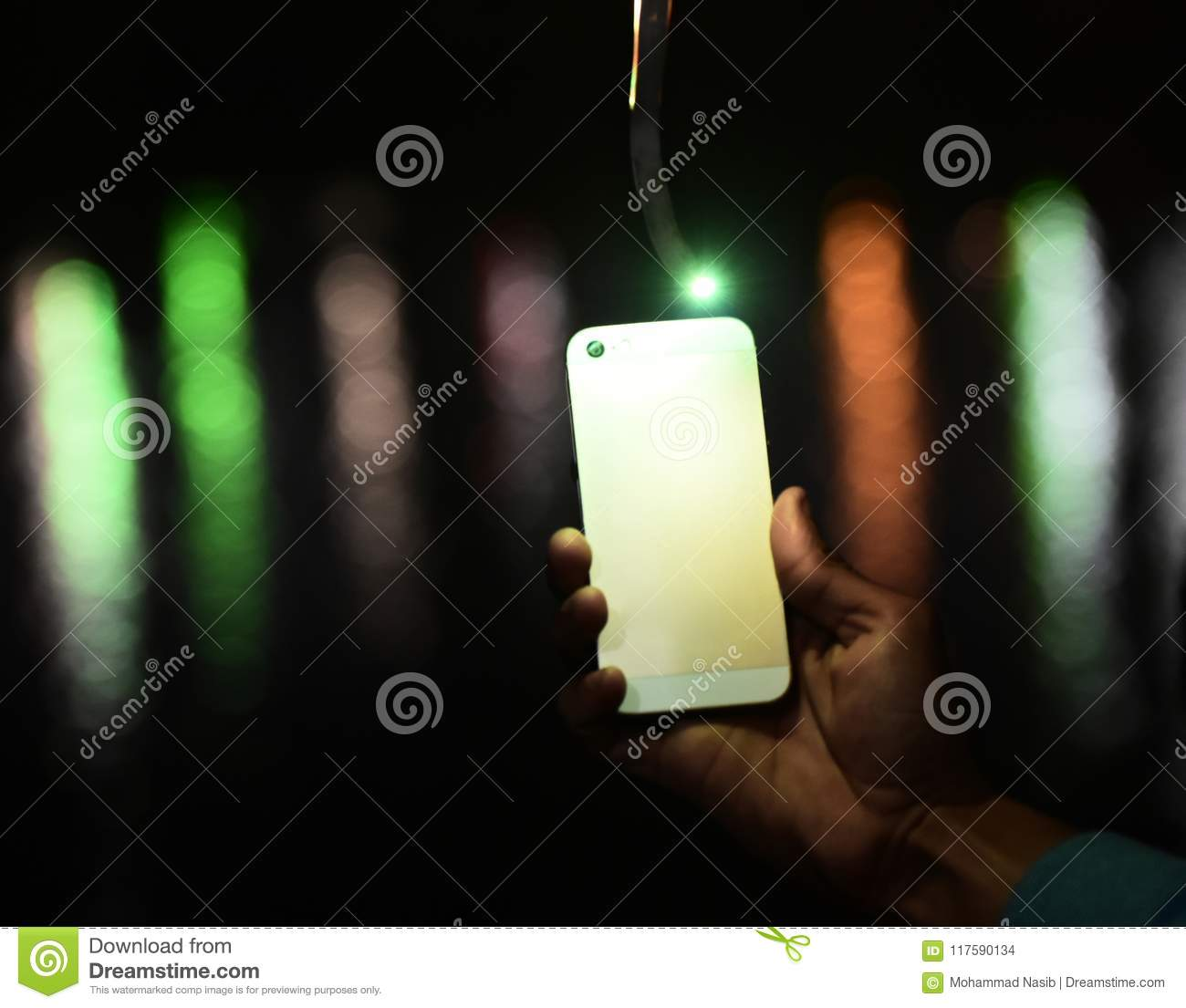 Download Man Holding A Mobile Phone In Hand With Blurred Background Photograph Stock Photo - Image of mobile, holding: 117590134