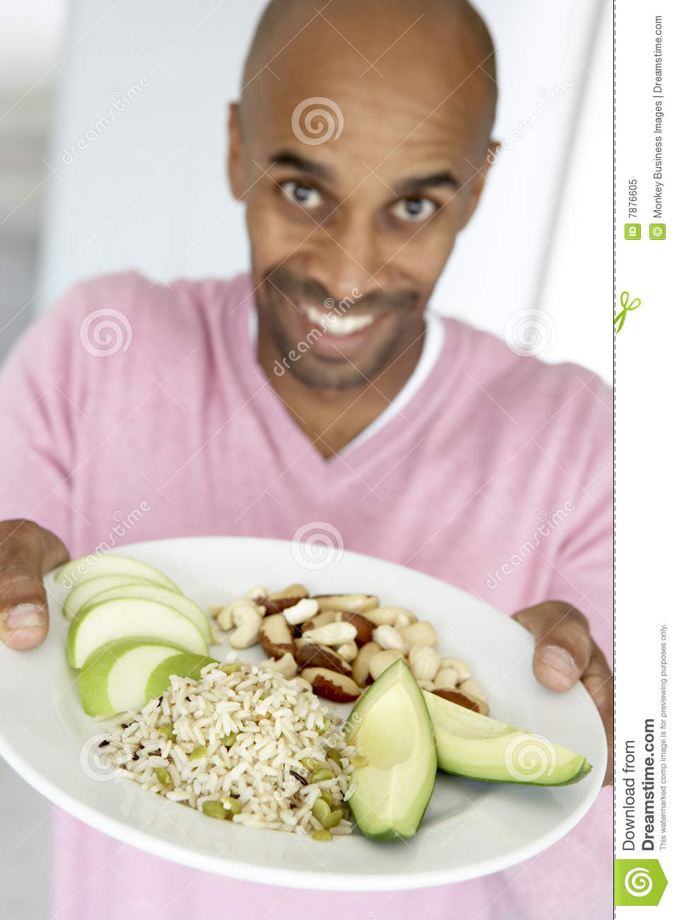 Man Holding Out A Plate With Healthy Foods Royalty Free
