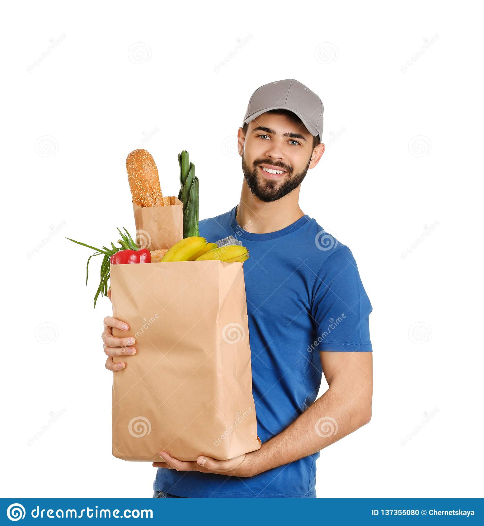 Man holding paper bag with fresh products on white. Food delivery service
