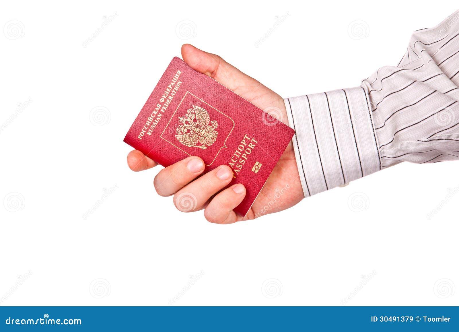 A man holding a passport