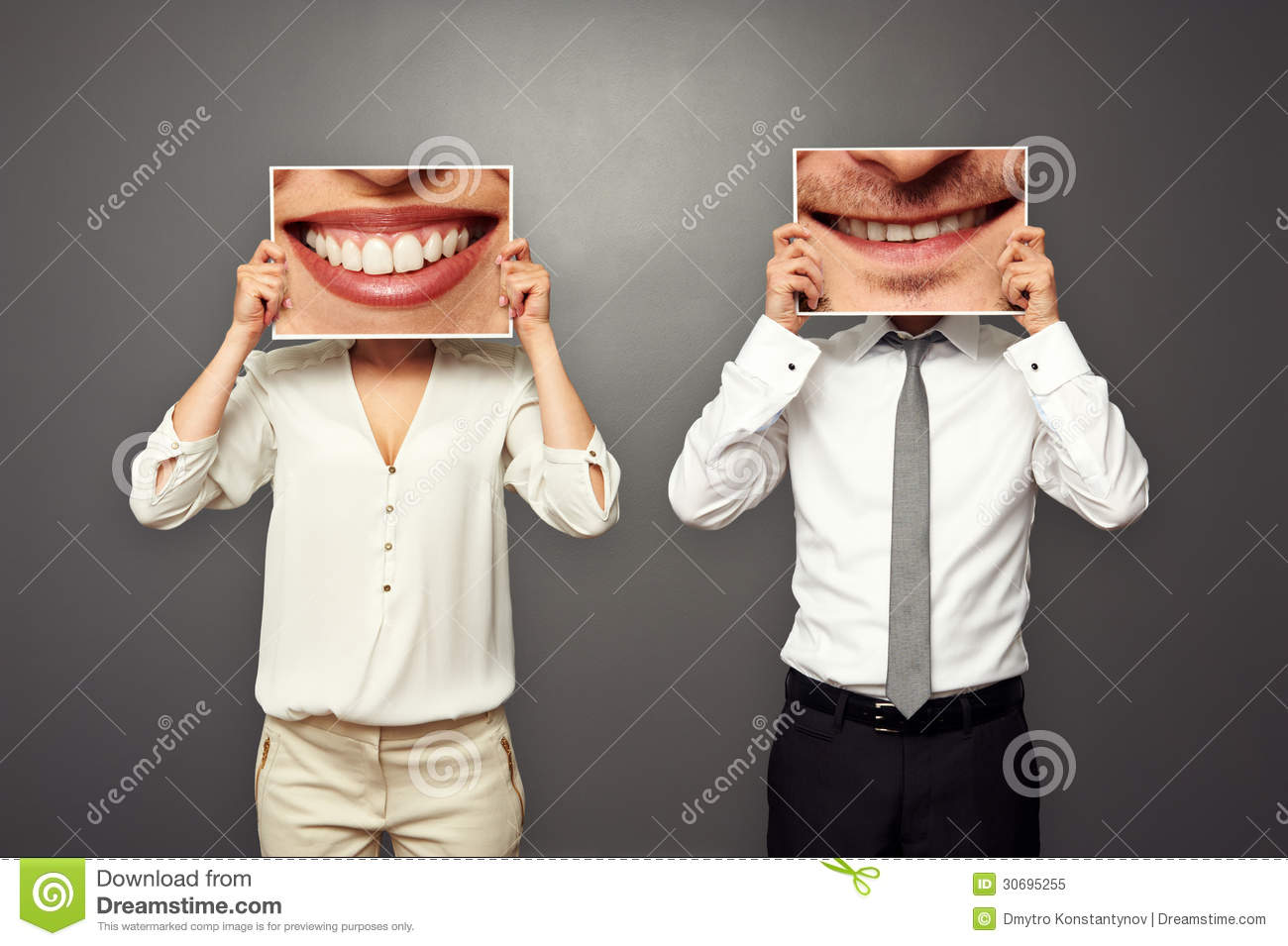 Man holding pictures with big smile