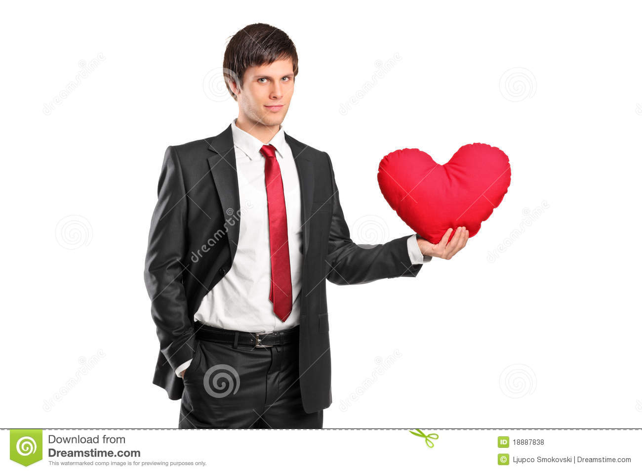 Man Shaped Pillow A Man Holding A Red Heart Shaped Pillow Royalty Free Stock Photos