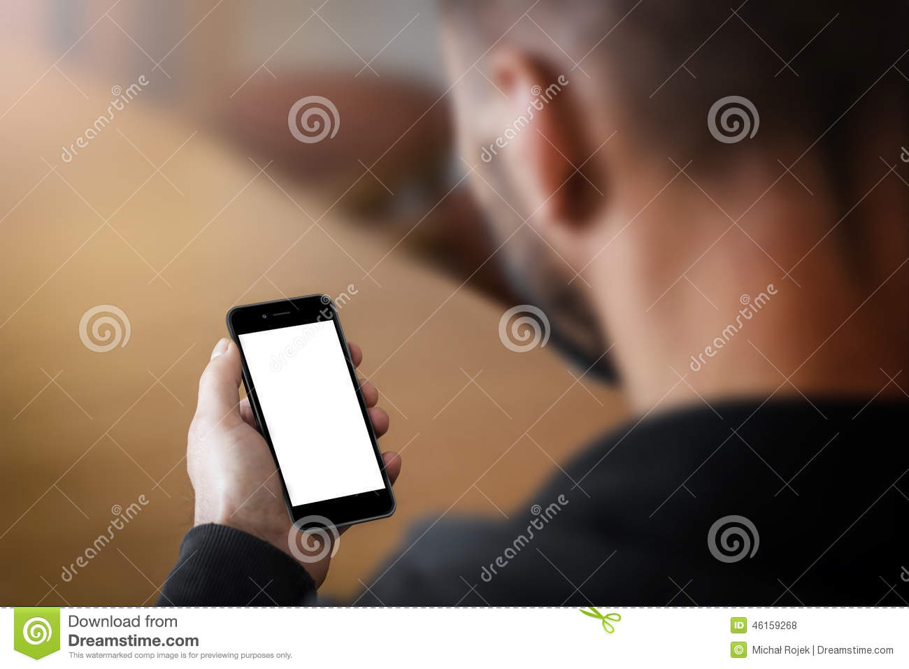 Man holding a smartphone with blank screen.